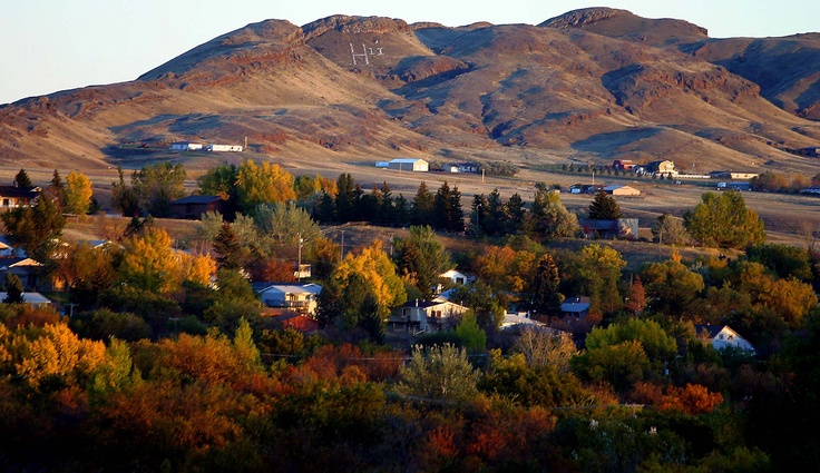 The soft glow of sunlight saturates the colors of fall looking toward Saddle Butte in Havre, Montana, on October 12, 2010. (Nikki Carlson/Havre Daily News/Associated Press)